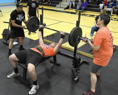 Winters Mill's Blake Billings bench presses during the Carroll County High School powerlifting meet at Westminster High School on June 3, 2017.