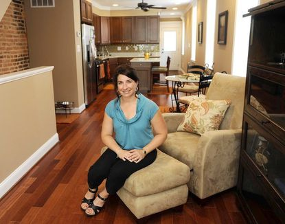 Dana Ostrenga sits in the living room of her dream home in Locust Point.