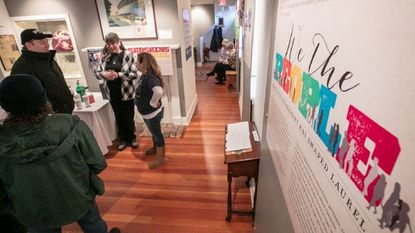 """Visitors gather during the reception for the """"We The People: How Civic Engagement has Shaped Laurel"""" exhibit by the Laurel Historical Society at the Laurel History Museum, 817 Main St."""