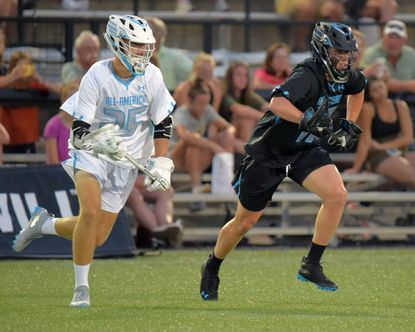 BJ Burlace (No. 17, right), shown playing for the South squad in the Under Armour All-American game last June, made the United States Under-19 national team as a long stick midfielder.