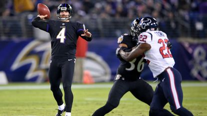 Baltimore Ravens punter Sam Koch (4) throws a pass on a fake punt play in the first half of an NFL football game against the Houston Texans, Monday, Nov. 27, 2017, in Baltimore. (AP Photo/Nick Wass)