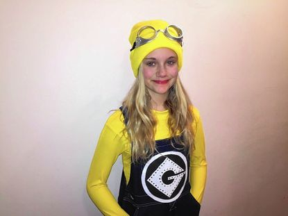 """Burleigh Manor Middle School eighth grader Jamie Cole plays a minion in the Columbia Figure Skating Club's annual spring show """"Movies and Minions."""""""