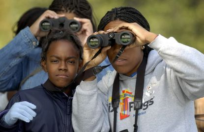 Students look for birds in Patterson Park