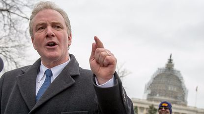 Sen. Chris Van Hollen, D-Md., speaks at an American Federation of Government Employees rally on Capitol Hill in 2015.