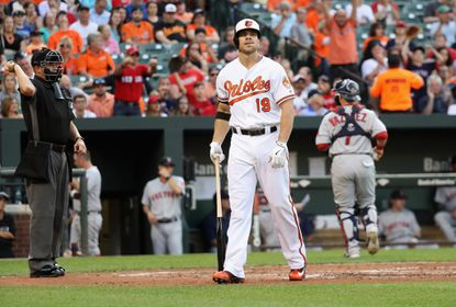 Chris Davis #19 of the Baltimore Orioles reacts after striking out swinging for the third out of the first inning against the Boston Red Sox at Oriole Park at Camden Yards on May 31, 2016 in Baltimore, Maryland.