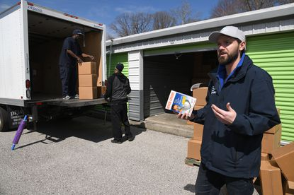 Nick Doetsch, right, co-owner of Pasadena Boat Works, talks about the masks and the donation. The co-owners of Pasadena Boat Works have a stockpile of approximately 14,000 N95 respirator masks, in a storage unit in Pasadena, that they are donating to the Maryland State Health Department.