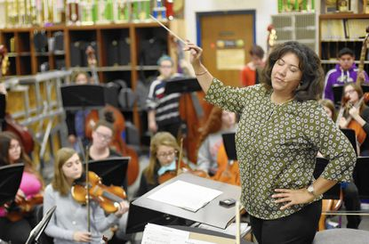 Instrumental music teacher Brandi Jason directs students during a class at Liberty High School in Eldersburg Tuesday, Nov. 1, 2016. Jason has been named as one of 25 semifinalists for the 2017 Music Rducator GRAMMY Award.
