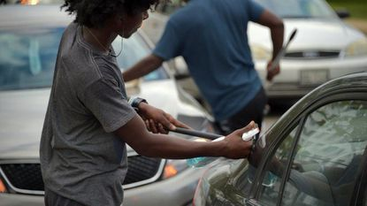 """Squeege kids"" at work on the windows of cars on southbound Monroe Street at Washington Boulevard."
