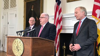 "Gov. Larry Hogan holds news conference to announce his ""lockbox"" proposal for casino revenue for education, flanked by Budget Secretary David R. Brinkley (left) and Comptroller Peter Franchot."