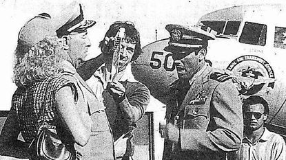 """Victoria Tennant, Robert Mitchum and Hart Bochner film a scene at Tipton Airport in Fort Meade for the 1988 mini-series """"War and Remembrance."""""""