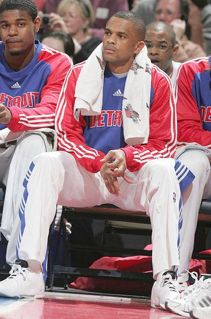 Juan Dixon sits on the bench as a member of the Detroit Pistons in 2008. Despite long odds, the former Terps star says he's working to make it back to the NBA.