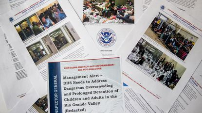 A portion of a report from government auditors reveals images of people penned into overcrowded Border Patrol facilities. (AP Photo/Andrew Harnik)