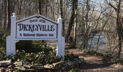 A sign stands near the mill In the historic Baltimore neighborhood of Dickeyville, which was founded in 1772.