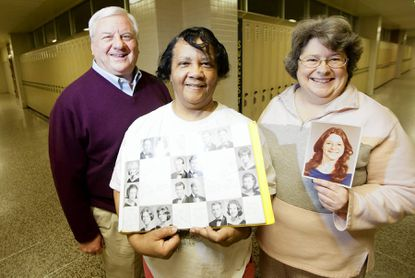 From left, Ed Miller of York, Mary Miller of Perry Hall and Cindy Horn of Fallston pose for a portrait with a yearbook from 1965 and Horn's senior photo at Perry Hall High School. Ed and Mary were a part of the original graduating class of '65 from the school. Horn graduated in '78. They are planning a celebration for the 50th anniversary of Perry Hall High School.