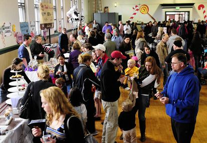 Folks wander through the many vendors lining the hall of the Bel Air Armory during last year's Bel Air Chocolate and Candy Festival. This year's festival is Saturday.