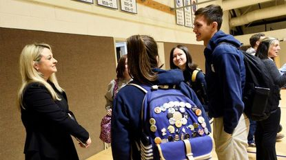 TV crime and investigative journalist Michelle Sigona, left, talks to seniors, from left, Kirsten Lawson, Karli Nisula, Elaina Epperson and Connor Welch following her presentation to students at Mount Airy Christian Academy on Tuesday, Jan. 22, 2019.