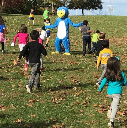 BB, the Pot Spring Elementary School mascot, cheers on kindergarten runners during the Race for Education, a fundraiser that is benefiting a new school-wide theater program.