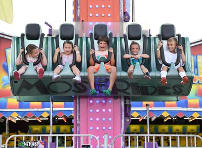 Carnival goers, from left, Isabel Lerch, McKayla DiMayo, Jackson Lerch, Allie and Blake Lindemann, enjoy the thrills as they take a ride on the Hip-Hop ride at the Jarrettsville Carnival Tuesday, June 8, 2021.