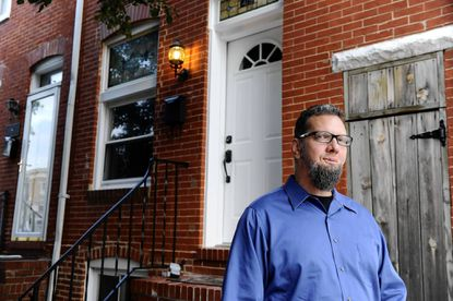 Chris Benedetti at his former home in Upper Fells Point. He priced it to sell quickly and it did.