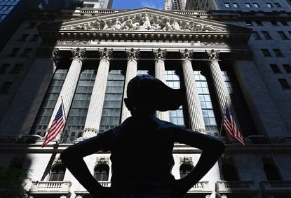 "(FILES) In this file photo The ""Fearless Girl"" statue stands in front of the New York Stock Exchange (NYSE) at Wall Street on June 29, 2020 in New York City. - Wall Street stocks opened decisively higher on July 13, 2020 as progress on a coronavirus vaccine offset unease at worsening outbreaks in many parts of the United States.About 10 minutes into trading, the Dow Jones Industrial Average stood at 26,298.79, up 0.9 percent.The broad-based S&P 500 gained 0.8 percent to 3,210.72, while the tech-rich Nasdaq Composite Index jumped 1.4 percent to 10,766.29, rising further from record levels. (Photo by Angela Weiss / AFP) (Photo by ANGELA WEISS/AFP via Getty Images)"