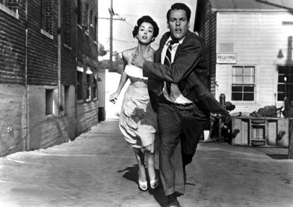 A scene from the movie INVASION OF THE BODY SNATCHERS, L–R: Kevin McCarthy, Dana Wynter, 1956. Courtesy Everett Collection. TURNER CLASSIC MOVIES