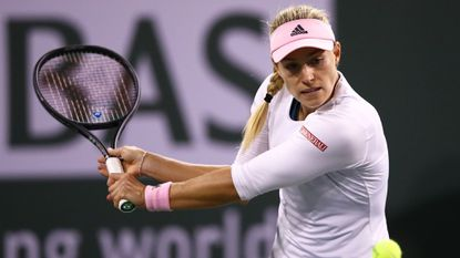 Angelique Kerber plays a backhand against Belinda Bencic during their women's singles semifinal match of the BNP Paribas Open at the Indian Wells Tennis Garden.