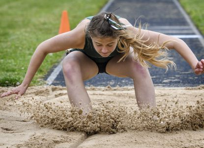 Century's Rileigh Mansfield lands her fourth attempt at 31 feet, 2.5 inches to win the girls' triple jump during the Carroll County outdoor track championship meet at held Manchester Valley High School on Saturday.