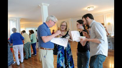 Rick and Louise Smith of Scaggsville, left, Carolyn Smith of Odenton and Dan Cox of Odenton enjoy samples from restaurants around Catonvsville during Monday's Taste of Catonsville event at Overhills Mansion.