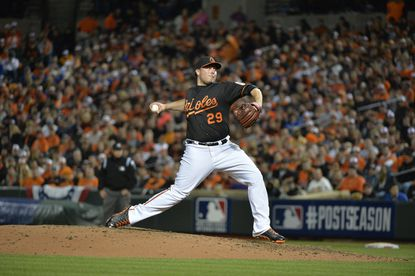 Orioles reliever Tommy Hunter pitches in the fifth inning of ALCS Game 1.
