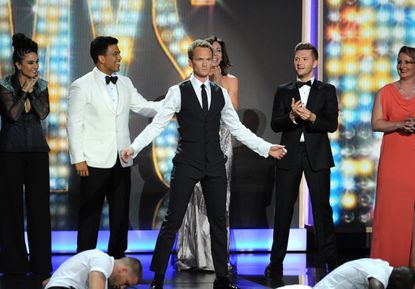 Neil Patrick Harris performs on-stage during the 2013 Emmys.