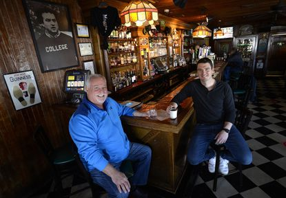After 30 years Jim Breuer, left, has sold Maggie's, the popular Westminster bar and restaurant, to new owner Thomas Zippelli, right.