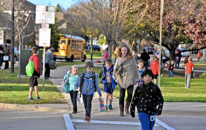 Students walk home from May Watts Elementary School at the end of the school day Friday. May Watts in Naperville, Ill., is one of five elementary schools in District 204 where Asian students are now the largest subgroup in the student population.