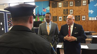 Gov. Larry Hogan speaks to Baltimore Police officers at a roll call in the Southwestern District alongside Commissioner Darryl De Sousa.