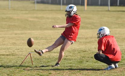 Westminster senior Lydia Houle, kicker on the varsity football team, attempts a field goal during a practice at the school on Monday, March 22, 2021.