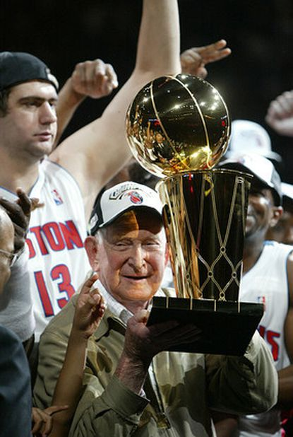 Detroit Pistons owner Bill Davidson holds the Larry O'Brien trophy for winning the NBA Championship against the Los Angeles Lakers at the Palace of Auburn Hills, Mich. Davidson, the Pistons' Hall of Fame owner and noted philanthropist, died March 13, 2009. He was 86.