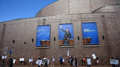 Baltimore Symphony Orchestra musicians walk the picket line outside the Meyerhoff Monday morning.