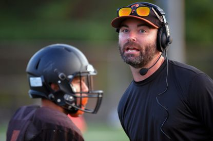 The Baltimore Ravens on Thursday named Oakland Mills' Thomas Browne its high school football coach of the week for Week 4.
