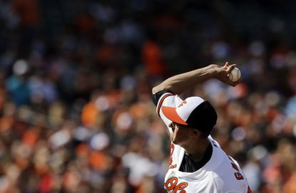 Orioles right-hander Kevin Gausman throws to the Toronto Blue Jays, Sunday, April 12, 2015, in Baltimore.
