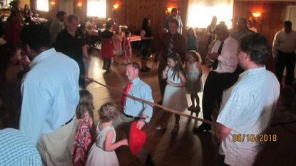 Dads Works will hold its eighth annual Daddy Daughter Dance on Saturday, June 1. A limbo game is pictured at last year's event.
