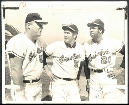 From left, Boog Powell, Brooks Robinson and Frank Robinson pose for a photo during the Orioles' 1970 World Series championship season.