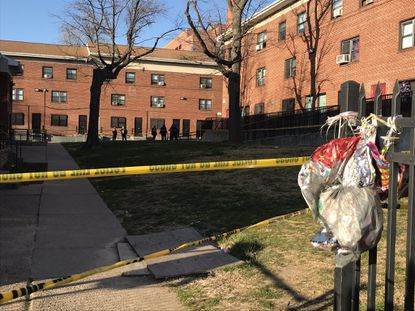Baltimore police officers set up a crime scene near the 1500 block of May Court on Feb. 23, where police say 32-year-old Jacqelin Burley was fatally shot.