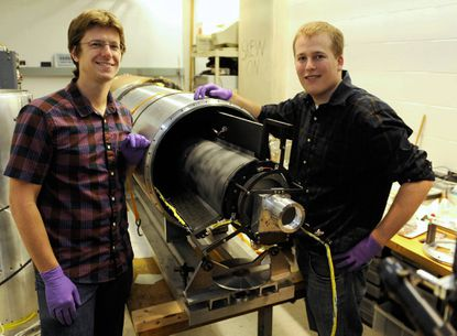 Johns Hopkins University PhD students Brian Fleming, left, and Keith Redwine, right, are working on a sounding rocket which could be launched in New Mexico in the spring of 2013.