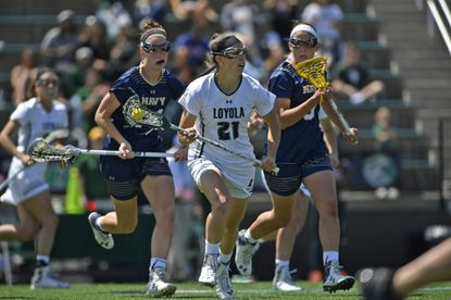 Loyola Maryland sophomore attacker Frankie Kamely (21) carries the ball up field against Navy in the Patriot League championship on May 8, 2016, at Ridley Athletic Complex.