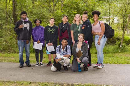 Ann Strozyk, back row, third from right, poses with Oakland Mills High School students during a field trip in 2016. Strozyk, a Howard County school system environmental educator at the Howard County Conservancy, was recently recognized as a Presidential Innovation Award for Environmental Educators winner from the U.S. Environmental Protection Agency.