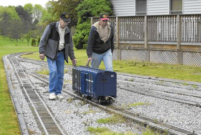 John Frederick and Glenn Sharpe build one-and-half scale trains at Sharpe's New Windsor home. The two will be part of the celebration next weekend at Mount Ida in Ellicott City.