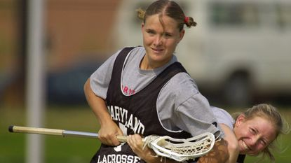Maryland women's lacrosse players Jen Adams, top front, and Meg McNamara kid around in practice April 27, 2001, in College Park.