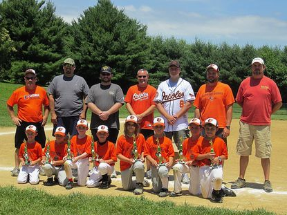 """The Orioles won the Finksburg Baseball Rookie League title on Father's Day weekend and several of the players' fathers handed out the trophies to their kids. Top Row: coach Joe Griffin, Bill Hofmann, John Clark, coach Brian O'Donnell, Craig Zentz, coach Jeff Gruenzinger, Bob LaForce. Bottom Row: Cole Griffin, Tameron Hofmann, Matt Clark, Nolan O'Donnell, Carlie Rosewag, Daniel Zentz, Jack Gruenzinger, Jake LaForce. Not pictured: coach Bill """"Pop"""" Griffin, coach Mark Korpa, TJ Korpa and Preston Lafferty."""