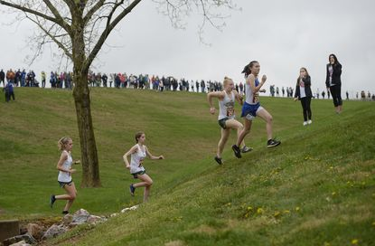 Runners climb a hill in the girls race of the Carroll County Cross Country Championships at Carroll Community College in Westminster Wednesday, April 14, 2021.