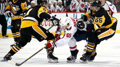 Capitals left wing Andre Burakovsky tries to split the defense of Pittsburgh's Brian Dumoulin (8) and Ron Hainsey (65) during Game 6 on Monday night.