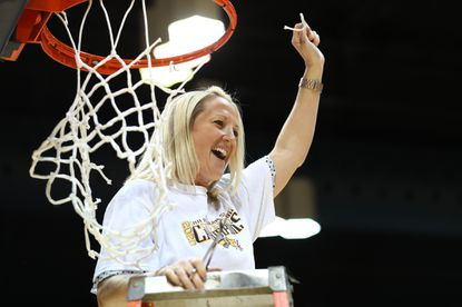 Amy Mallon, pictured cutting down the nets after Drexel won a share of the 2020 Colonial Athletic Association regular-season title, was introduced Wednesday as Drexel women's basketball coach.